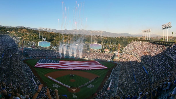 Planes fly over Dodgers Stadium before Game 1 of baseball's World Series between the Houston Astros and the Los Angeles Dodgers Tuesday, Oct. 24, 2017, in Los Angeles. (AP Photo/Tim Donnelly)