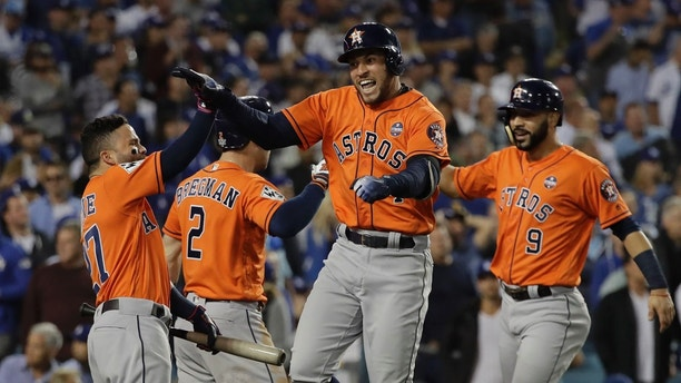 Houston Astros' George Springer reacts after hitting a two-run home run during the second inning of Game 7 of baseball's World Series against the Los Angeles Dodgers Wednesday, Nov. 1, 2017, in Los Angeles. (AP Photo/David J. Phillip)