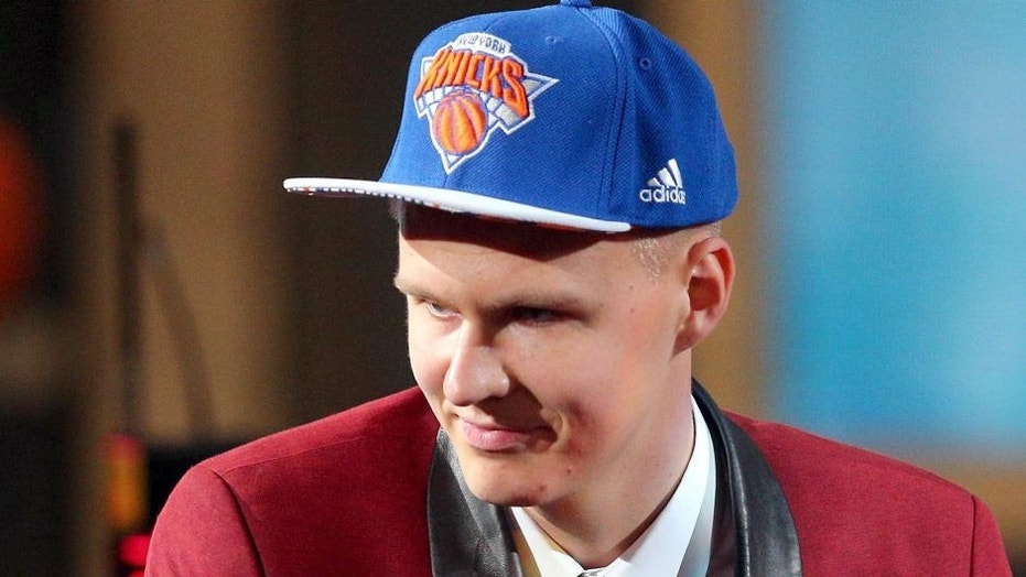 Kristaps Porzingis reacts after being selected as the No. 4 overall pick in the 2015 NBA Draft, June 25, 2015.