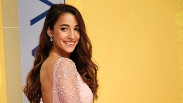 Olympic gymnast Aly Raisman arrives at the 50th Annual Country Music Association Awards in Nashville, Tennessee, U.S., November 2, 2016. REUTERS/Jamie Gilliam - HT1ECB21TSCCR