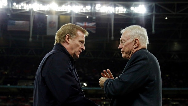 "FILE - In this Nov. 9, 2014, file photo, NFL commissioner Roger Goodell, left, and Dallas Cowboys owner Jerry Jones talk during an NFL football game between the Jacksonville Jaguars and Cowboys at Wembley Stadium in London. The NFL expects a five-year contract extension with Commissioner Roger Goodell to be finalized soon, despite a threatened lawsuit by Dallas Cowboys owner Jerry Jones. NFL spokesman Joe Lockhart said Thursday, Nov. 9, 2017, that ""our expectation is this will be wrapped up soon, but we can't project an actual date.""(AP Photo/Matt Dunham, File)"