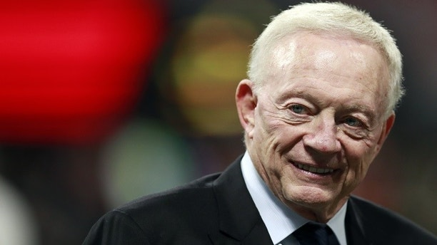 Dallas Cowboys owner Jerry Jones walks the turf inside Mercedes-Benz stadium before the first half of an NFL football game between the Atlanta Falcons and the Dallas Cowboys, Sunday, Nov. 12, 2017, in Atlanta. (Jeff Haynes/AP Images for Panini)