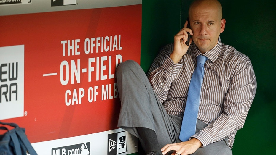 Ex-Braves GM banned for life by MLB; Atlanta loses prospects