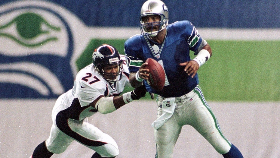 Moon played for four NFL teams over 17 seasons. He is seen here playing for the Seattle Seahawks in 1998.