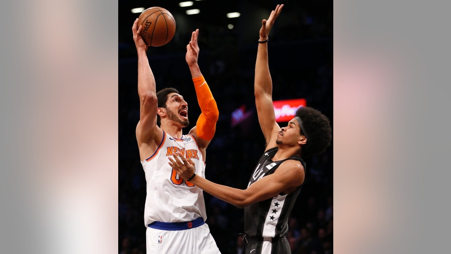 Enes Kanter, left, of the New York Knicks, plays against the Brooklyn Nets in an NBA game in New York City, Dec. 14, 2017.