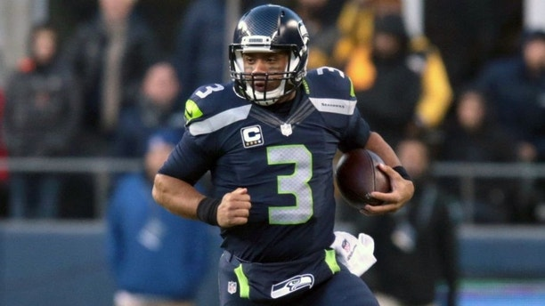 Nov 29, 2015; Seattle, WA, USA; Seattle Seahawks quarterback Russell Wilson (3) runs the ball in the fourth quarter against the Pittsburgh Steelers at CenturyLink Field. Mandatory Credit: Scott Olmos-USA TODAY Sports