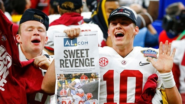 Alabama quarterback Mac Jones (10) celebrates with fans after defeating Clemson in the Sugar Bowl semi-final playoff game for the NCAA college football national championship, in New Orleans, Monday, Jan. 1, 2018. Alabama won 24-6 to advance to the national championship game. (AP Photo/Butch Dill)