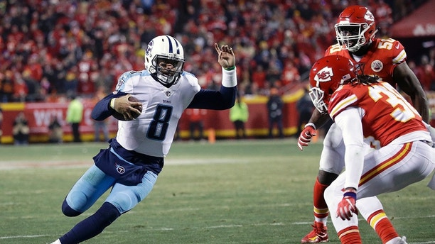 Tennessee Titans quarterback Marcus Mariota (8) carries the ball as Kansas City Chiefs defensive back Ron Parker (38) and linebacker Justin Houston (50) defend during the second half of an NFL wild-card playoff football game in Kansas City, Mo., Saturday, Jan. 6, 2018. (AP Photo/Charlie Riedel)