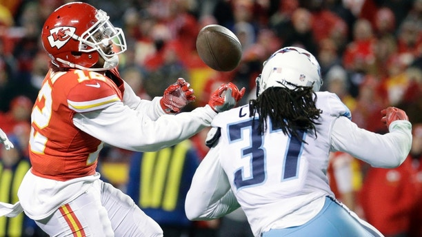 Kansas City Chiefs wide receiver Albert Wilson (12) can't reach a pass against Tennessee Titans safety Johnathan Cyprien (37) during the second half of an NFL wild-card playoff football game in Kansas City, Mo., Saturday, Jan. 6, 2018. (AP Photo/Charlie Riedel)