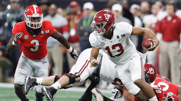 Alabama quarterback Tua Tagovailoa runs during the second half of the NCAA college football playoff championship game against Georgia, Monday, Jan. 8, 2018, in Atlanta. (AP Photo/David Goldman)