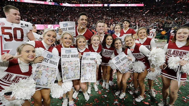 Alabama cheerleaders celebrate after overtime of the NCAA college football playoff championship game against Georgia Monday, Jan. 8, 2018, in Atlanta. Alabama won 26-23. (AP Photo/David J. Phillip)