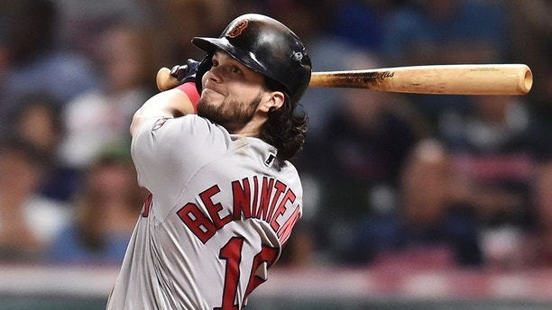 Aug 22, 2017; Cleveland, OH, USA; Boston Red Sox left fielder Andrew Benintendi (16) hits an RBI double during the seventh inning against the Cleveland Indians at Progressive Field. Mandatory Credit: Ken Blaze-USA TODAY Sports - 10234580