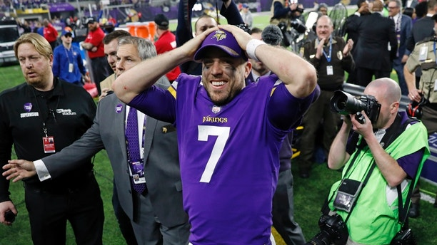 Minnesota Vikings quarterback Case Keenum (7) celebrates following a 29-24 win over the New Orleans Saints in an NFL divisional football playoff game in Minneapolis, Sunday, Jan. 14, 2018. (AP Photo/Charlie Neibergall)
