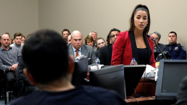 Victim and former gymnast Aly Raisman speaks at the sentencing hearing for Larry Nassar, (L) a former team USA Gymnastics doctor who pleaded guilty in November 2017 to sexual assault charges, in Lansing, Michigan, U.S., January 19, 2018. REUTERS/Brendan McDermid - RC1AC9929600