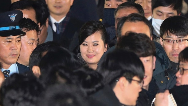 North Korean Hyon Song Wol, center, head of North Korea's art troupe, arrives at the Seoul Train Station in Seoul, South Korea, Sunday, Jan. 21, 2018. The head of a hugely popular girl band arrived in South Korea on Sunday across the rivals' heavily fortified border to check preparations for a Northern art troupe she also leads during next month's Winter Olympics in South Korea. (Korea Pool Photo via AP)