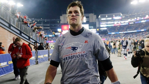 New England Patriots quarterback Tom Brady leaves the field after winning the AFC championship NFL football game against the Jacksonville Jaguars, Sunday, Jan. 21, 2018, in Foxborough, Mass. The Patriots won 24-20. (AP Photo/Winslow Townson)
