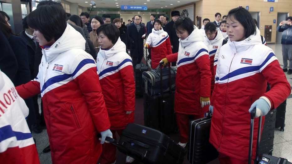 North Korean women's hockey players arrive at the Inter-Korean Transit Office in Paju, South Korea, Thursday.