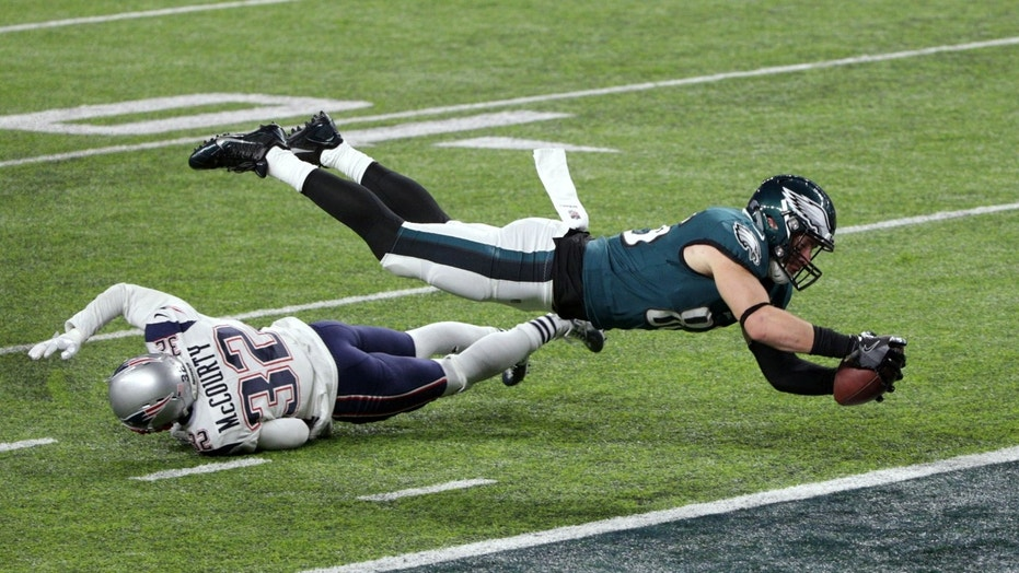 Feb 4, 2018; Minneapolis, MN, USA; Philadelphia Eagles tight end Zach Ertz (86) scores a touchdown over defender New England Patriots free safety Devin McCourty (32) during the fourth quarter in Super Bowl LII at U.S. Bank Stadium. Mandatory Credit: Brad Rempel-USA TODAY Sports - 10588477