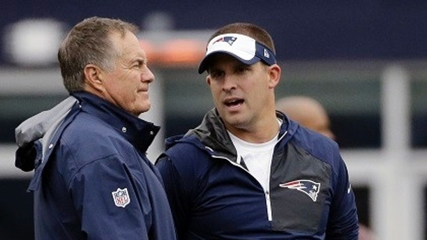 FILE - In this Oct. 2, 2016, file photo, New England Patriots head coach Bill Belichick, left, and offensive coordinator Josh McDaniels talk before an NFL football game against the Buffalo Bills in Foxborough, Mass. The Indianapolis Colts announced Tuesday, Feb. 6, 2018, that hey have hired Josh McDaniels as their new head coach. (AP Photo/Elise Amendola, File)