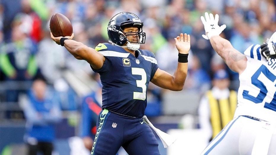 Seattle Seahawks quarterback Russell Wilson, seen in this file photo, will reportedly join the Double-A Trenton team for the New York Yankees.