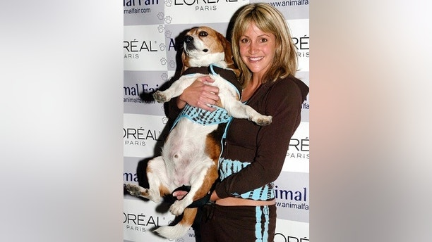 "Summer Sanders poese with her dog ""Small"" as she arrives at a ""Paws For