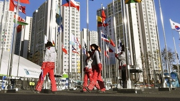 Flags of participating countries flutter in the wind at the Olympic village in Gangnueng, South Korea, Thursday, Feb. 1, 2018.  In a rare sight, North Korean flags flew in South Korea on Thursday as the South prepared for the Winter Olympics that has brought a temporary lull in tensions surrounding the North's nuclear program.  The Olympic village in Gangneung turned into a selfie site as volunteer workers posed under a North Korean flag that has been raised in the country for the first time since a hockey tournament in April last year.  (Daisuke Suzuki/Kyodo News via AP)