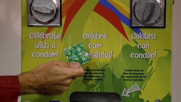 Condom dispenser is seen during a guided tour for journalists to the 2016 Rio Olympics Village in Rio de Janeiro, Brazil, July 23, 2016. REUTERS/Ricardo Moraes   Picture Supplied by Action Images - MT1ACI14486501