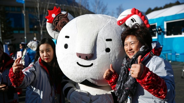 Volunteers pose with mascot Soohorang inside the Pyeongchang Olympic Village prior to the 2018 Winter Olympics in Pyeongchang, South Korea, Wednesday, Feb. 7, 2018. (AP Photo/Patrick Semansky)