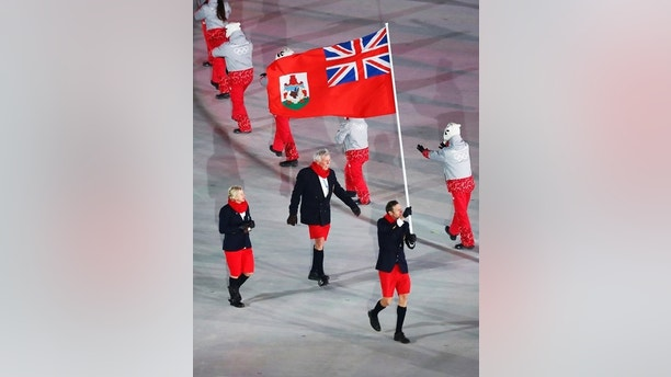 Tucker Murphy carries the flag of Bermuda during the opening ceremony of the 2018 Winter Olympics in Pyeongchang, South Korea, Friday, Feb. 9, 2018. (AP Photo/Matthias Schrader)