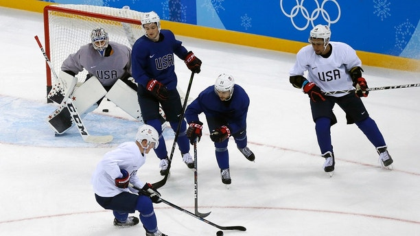 Members of the United States men's hockey team practice ahead of the 2018 Winter Olympics in Gangneung, South Korea, Friday, Feb. 9, 2018. (AP Photo/Kiichiro Sato)
