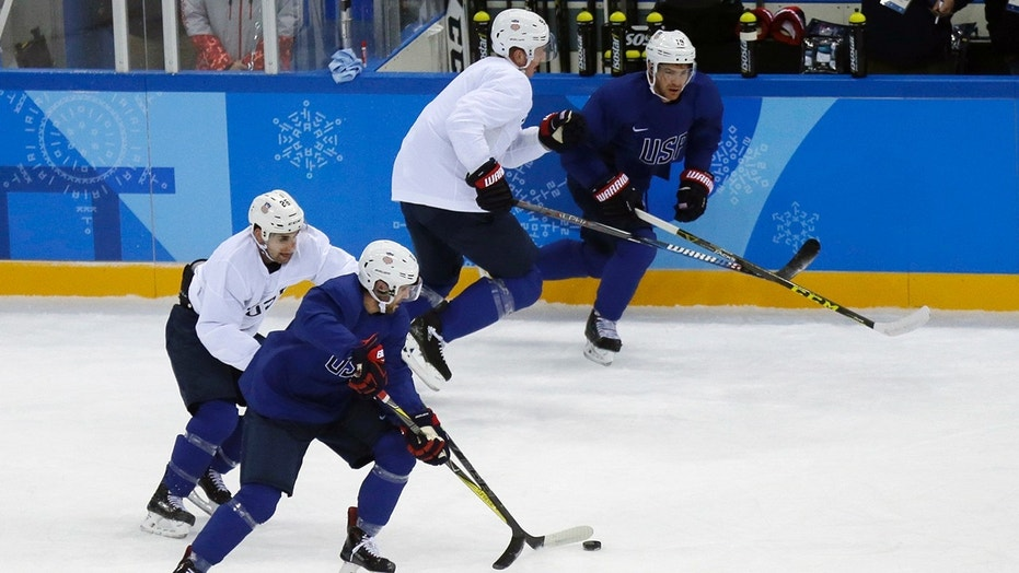 United State's Ryan Gunderson battles controls the puck against Mark Arcobello, left, during practice ahead of the 2018 Winter Olympics in Gangneung, South Korea, Friday, Feb. 9, 2018. (AP Photo/Kiichiro Sato)