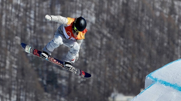 Jamie Anderson, of the United States, jumps during the women's slopestyle final at Phoenix Snow Park at the 2018 Winter Olympics in Pyeongchang, South Korea, Monday, Feb. 12, 2018. (AP Photo/Gregory Bull)