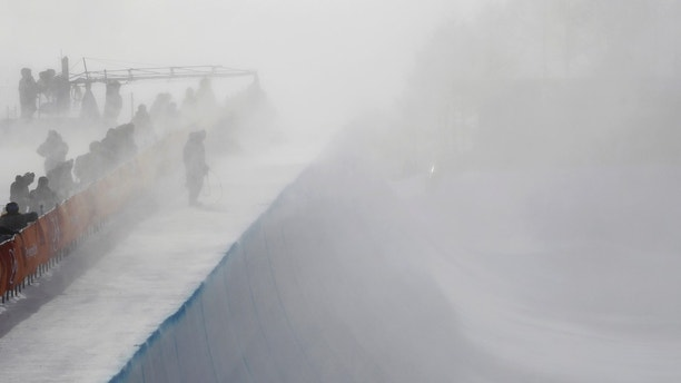 Wind gust engulfs the half pipe course during the women's halfpipe qualifying at Phoenix Snow Park at the 2018 Winter Olympics in Pyeongchang, South Korea, Monday, Feb. 12, 2018. (AP Photo/Gregory Bull)