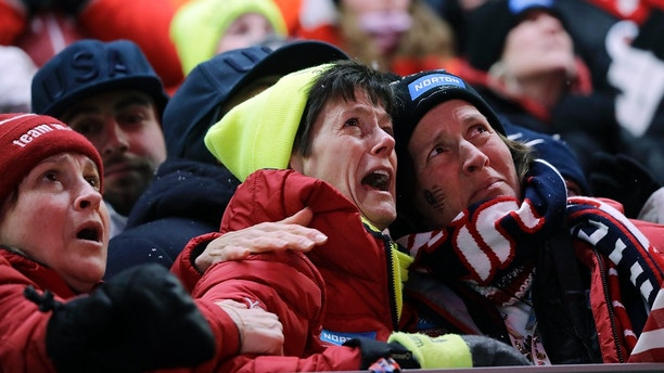 Sue Sweeney, center, the mother of Emily Sweeney of the United States, cries out as her daughter crashes on the final run during the women's luge final at the 2018 Winter Olympics in Pyeongchang, South Korea, Tuesday, Feb. 13, 2018. (AP Photo/Wong Maye-E)