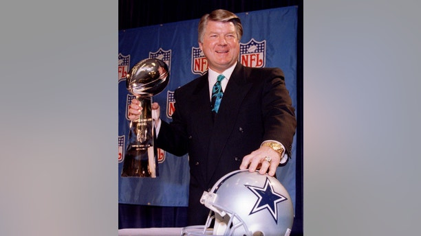 FILE PHOTO 28JAN94 - Dallas Cowboy's coach Jimmy Johnson poses with the Vince Lombardi Trophy prior to his team's winning the Super Bowl XXVIII against the Buffalo Bills January 28, 1994. Johnson, who has been the Miami Dolphins head coach and general manager the past two seasons, has reportedly stepped down as coach of the Dolphins, according to a CNN/SI report January 13. Johnson took the Cowboys to back-to-back Super Bowl titles, only the third coach in NFL history to do so.