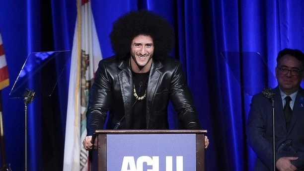 FILE - In this Dec. 3, 2017, file photo, Colin Kaepernick attends the 2017 ACLU SoCal's Bill of Rights Dinner at the Beverly Wilshire Hotel in Beverly Hills, Calif. Despite their vastly divergent methods, Colin Kaepernick and LeBron James helped set a stake in the ground, declaring to athletes across all sports that their platforms could be used for more than fun and games in the 21st century. (Photo by Richard Shotwell/Invision/AP, File)