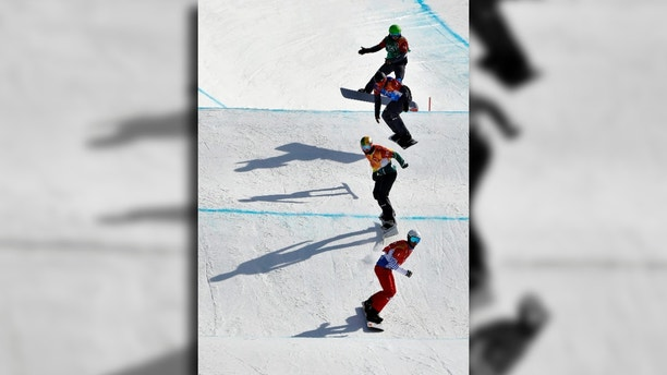 From bottom to top; Pierre Vaultier, of France, Jarryd Hughes, of Australia, Markus Schairer, of Austria, and Hanno Douschan, of Austria, runs the course during the men's snowboard cross elimination round at Phoenix Snow Park at the 2018 Winter Olympics in Pyeongchang, South Korea, Thursday, Feb. 15, 2018. (AP Photo/Gregory Bull)