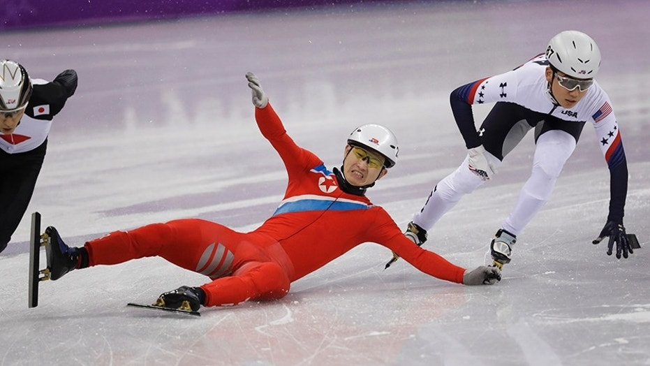 Jong Kwang Bom of North Korea crashes during their men's 500 meters short track speedskating heat in the Gangneung Ice Arena at the 2018 Winter Olympics in Gangneung, South Korea on Tuesday.