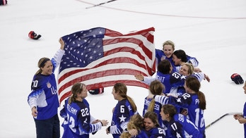 United States celebrates winning gold after the women's gold medal hockey game against Canada at the 2018 Winter Olympics in Gangneung, South Korea, Thursday, Feb. 22, 2018. (AP Photo/Matt Slocum)