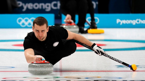FILE - In this Feb. 7, 2018 file photo, Russian curler Alexander Krushelnitsky practices ahead of the 2018 Winter Olympics in Gangneung, South Korea. Russian curlers say a coach on their team told them that mixed doubles bronze medalist Krushelnitsky tested positive for a banned substance at the Pyeongchang Olympics. (AP Photo/Aaron Favila, File)