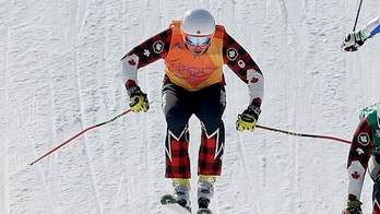 From left; Dave Duncan, of Canada, Kevin Drury, of Canada, Arnaud Bovolenta, of France, and Russian athlete Sergey Ridzik run the course during the men's ski cross semifinal at Phoenix Snow Park at the 2018 Winter Olympics in Pyeongchang, South Korea, Wednesday, Feb. 21, 2018. (AP Photo/Lee Jin-man)