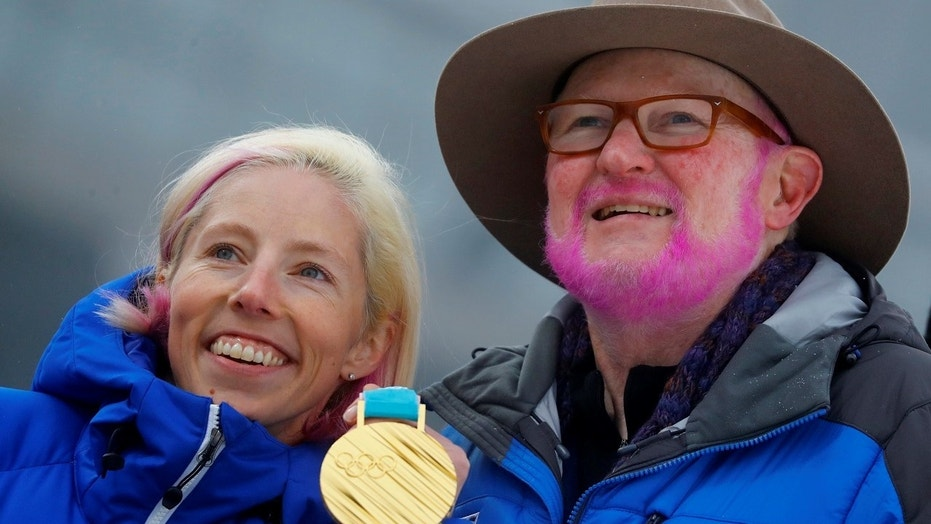 Tom Kelly, Vice President, Communication at the U.S. Ski and Snowboard Association, painted his beard pink after Kikklan Randall won gold.