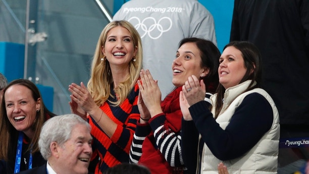 Curling - Pyeongchang 2018 Winter Olympics - Men's Final - Sweden v U.S. - Gangneung Curling Center - Gangneung, South Korea - February 24, 2018 - U.S. President Donald Trump's daughter and senior White House adviser, Ivanka Trump, and White House Press Secretary Sarah Huckabee Sanders applaud during the men's final. REUTERS/John Sibley - DEVEE2O0OUI30