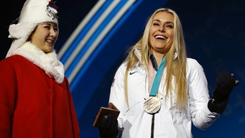 Bronze medalist in the women's downhill Lindsey Vonn, of the United States, smiles during the medals ceremony at the 2018 Winter Olympics in Pyeongchang, South Korea, Wednesday, Feb. 21, 2018. (AP Photo/Charlie Riedel)