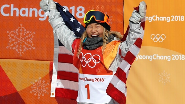 Snowboarding - Pyeongchang 2018 Winter Olympics - Women's Halfpipe Finals - Phoenix Snow Park - Pyeongchang, South Korea - February 13, 2018 - Chloe Kim of the U.S. celebrates her win. REUTERS/Jorge Silva - DEVEE2D07MRXT