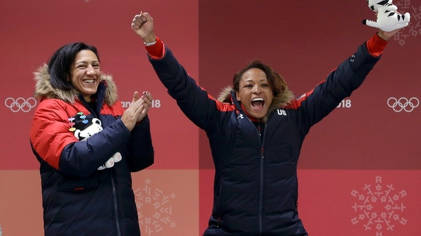Driver Elana Meyers Taylor, left, and Lauren Gibbs, right, of the United States celebrate winning the silver medal during the women's two-man bobsled final at the 2018 Winter Olympics in Pyeongchang, South Korea, Wednesday, Feb. 21, 2018. (AP Photo/Michael Sohn)