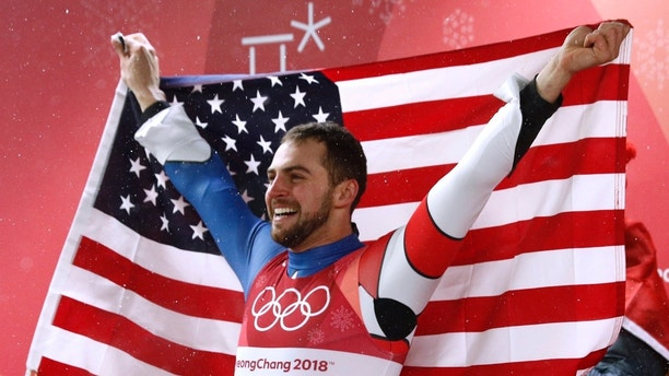 Luge – Pyeongchang 2018 Winter Olympics – Men's Singles Competition – Olympic Sliding Centre - Pyeongchang, South Korea – February 11, 2018 - Chris Mazdzer of the U.S celebrates second place. REUTERS/Edgar Su - DEVEE2B12ALUR