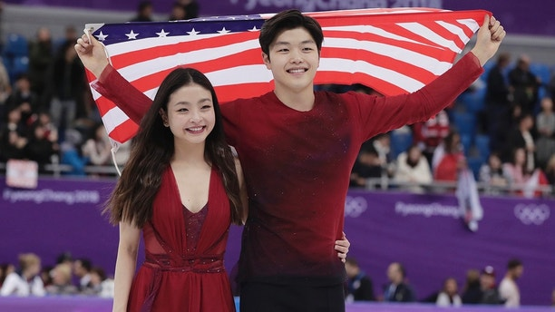 Maia Shibutani and Alex Shibutani of the United States celebrate during the venue ceremony after winning the bronze medal in the ice dance, free dance figure skating final in the Gangneung Ice Arena at the 2018 Winter Olympics in Gangneung, South Korea, Tuesday, Feb. 20, 2018. (AP Photo/Julie Jacobson)