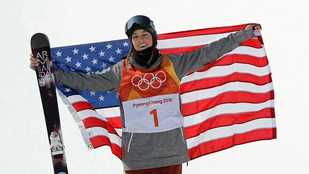 Brita Sigourney, of the United States, celebrates after winning the bronze medal in the women's halfpipe final at Phoenix Snow Park at the 2018 Winter Olympics in Pyeongchang, South Korea, Tuesday, Feb. 20, 2018. (AP Photo/Kin Cheung)