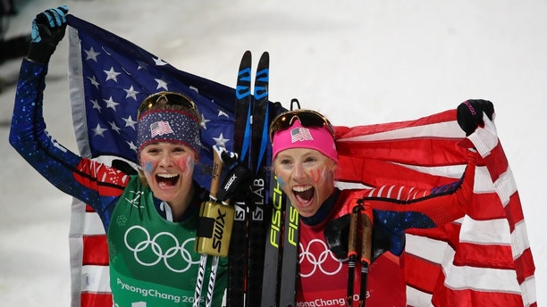 Cross-Country Skiing - Pyeongchang 2018 Winter Olympics - Women's Team Sprint Free Finals - Alpensia Cross-Country Skiing Centre - Pyeongchang, South Korea - February 21, 2018 -  Jessica Diggins and Kikkan Randall of the U.S. celebrate. REUTERS/Carlos Barria - DEVEE2L0T2AC6